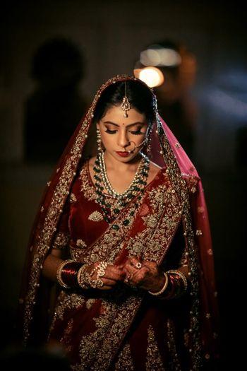 Maroon bridal lehenga with darker jewellery