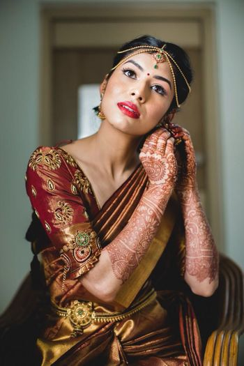 South Indian bridal look with dull gold kanjivaram