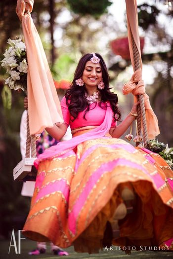 Mehendi day bridal portrait with bride on swing
