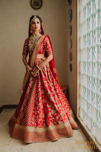 Photo of Red and gold bridal lehenga with floral work embroidery