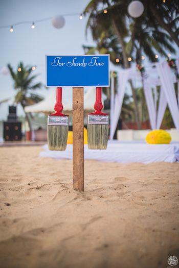 Beach wedding idea with brush to remove sand