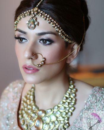 Subtle bridal makeup light pink