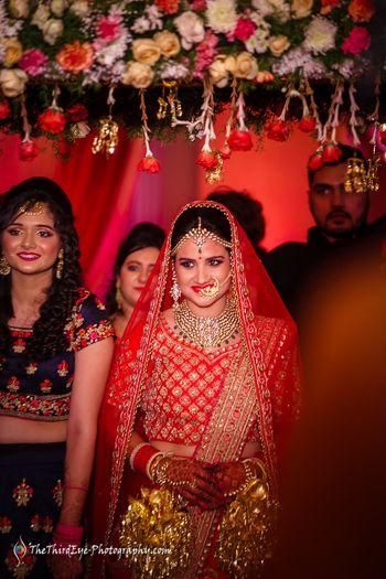 Bride in red under roses phoolon ka chadar
