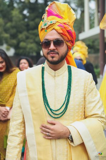 Multicolour groom look with yellow sherwani