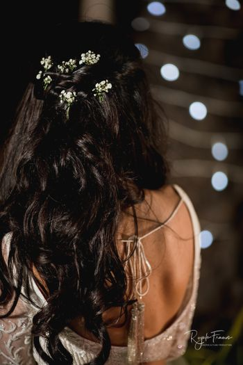 Engagement hairstyle with open hair and babys breath