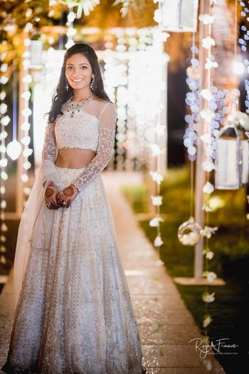Photo of Beautiful white lehenga with a sheer blouse for engagement