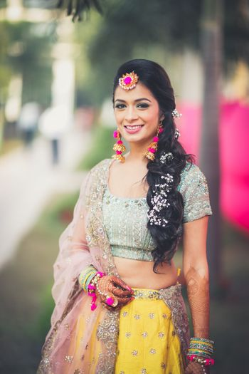 Simple mehendi look with gota jewellery and floral braid