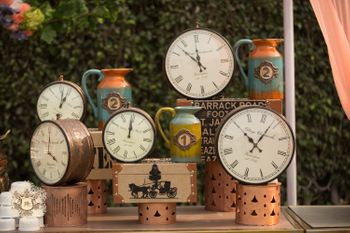 Unique vintage clocks and trunks themed decor for a day function