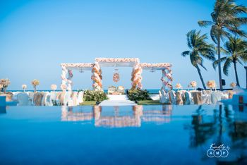 Stunning open air floral mehendi set up in white and orange