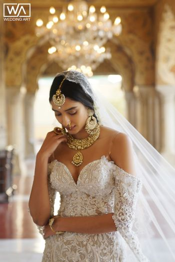 Strapless wedding gown with gold jewellery