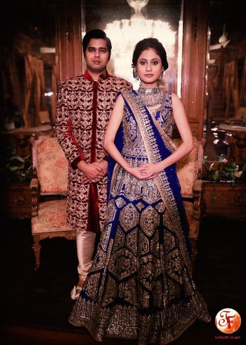 Beautiful royal blue lehenga with work all over and groom in maroon sherwani