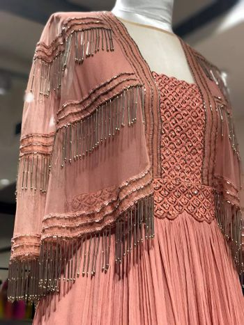 Stunningnude pink indo western outfit with tasseled jacket details