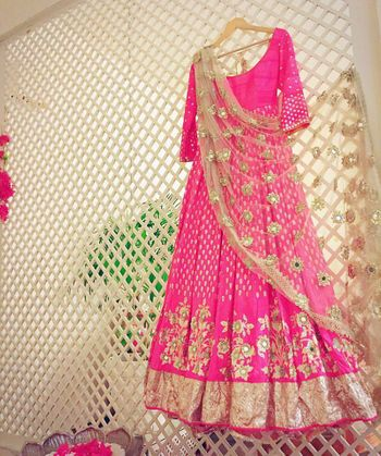 Stunning bright pink and gold floor length anarkali with work all over