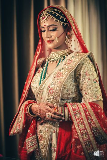 Offbeat bride with green and red lehenga