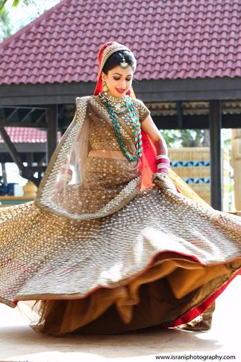 Twirling Bride in Copper Lehenga