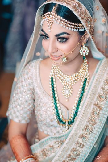 Photo of Bride wearing offbeat lehenga and contrasting jewellery