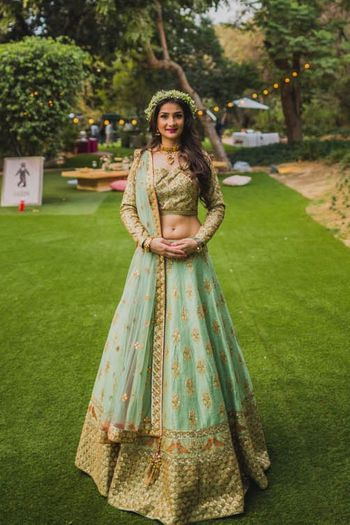 Engagement lehenga for bride in light blue and dull gold