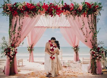 Photo of Couple portrait in pretty beach wedding mandap