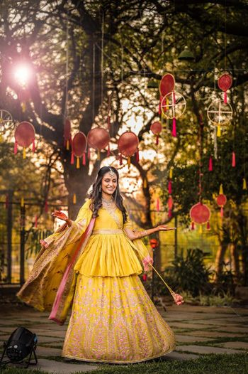 Pretty yellow lehenga with long peplum blouse