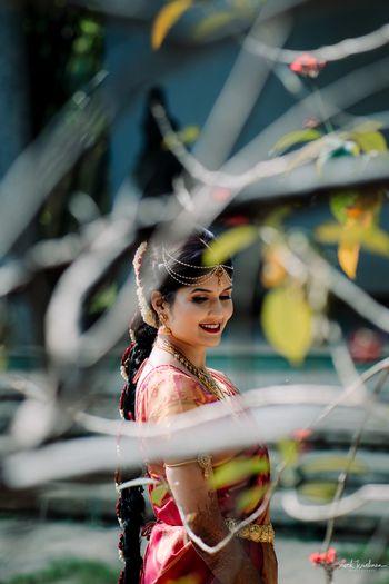 South Indian bridal portrait through tree