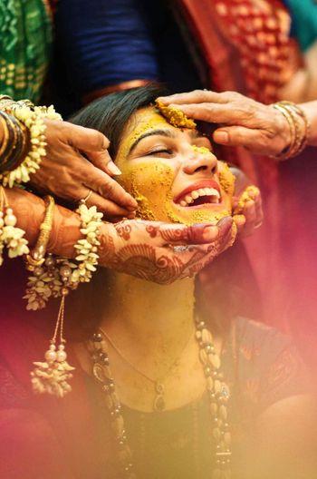 Happy bride shot on haldi