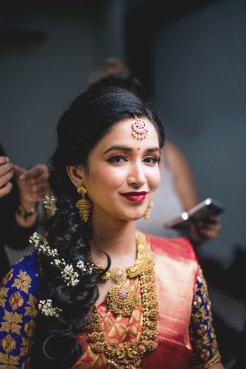 Pretty south indian bridal portrait while getting ready