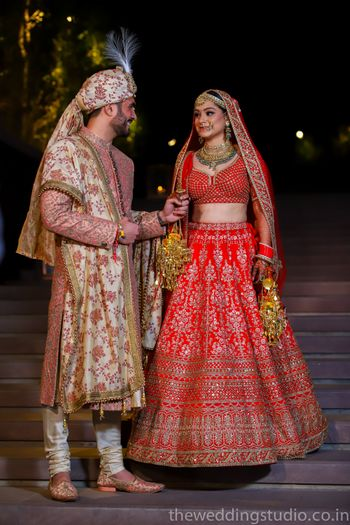 Mismatched bride and groom in floral sherwani