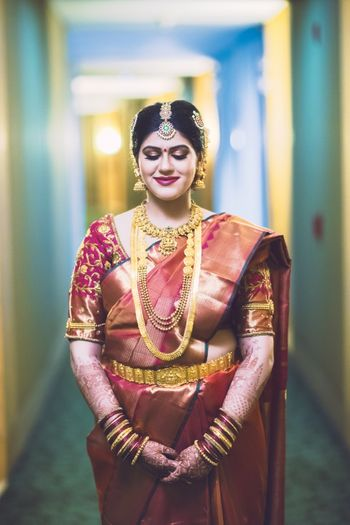 South Indian bride in brown and gold saree