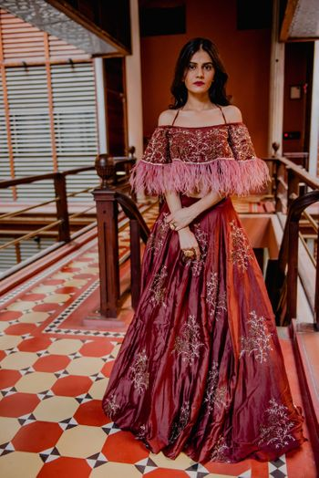 Maroon gown for sangeet with fur