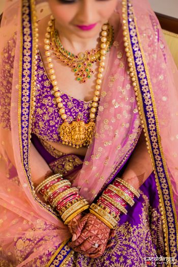 Offbeat bridal lehenga with temple jewellery