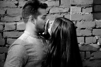 Funny couple kissing shot during pre wedding shoot