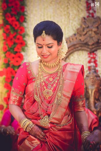 South Indian bride in all red and gold kanjivaram saree