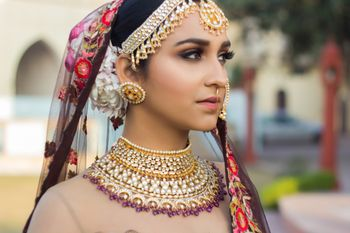 Photo of Bride wearing bib necklace and round earrings