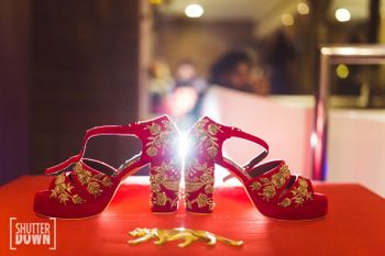 Photo of Zardozi work red and gold bridal shoes