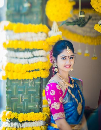 South Indian Bride in Blue and Pink Saree