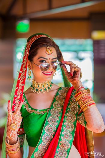 Cool bride shot in green lehenga wearing sunglasses