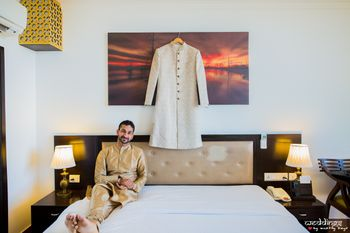 Photo of Groom with sherwani on hanger shot