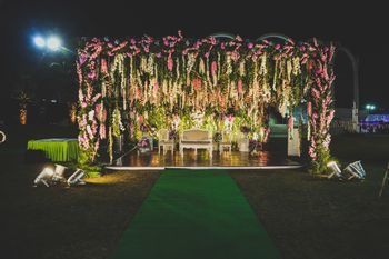Stunning outdoor decor stage with pink and white florals