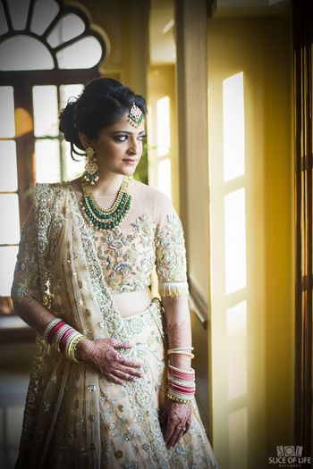 Cream embellished lehenga for engagement