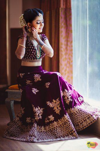 Photo of Purple velvet bridal lehenga