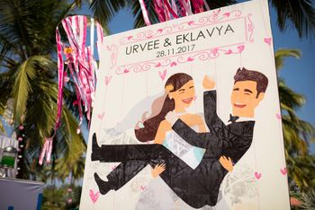 Bride and groom caricature entrance decor