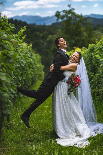 Amazing vinyard white wedding with a fun couple portrait