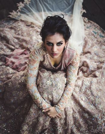 Photo of Stunning bridal portrait with bride donning a pink and grey lehenga with heavy work