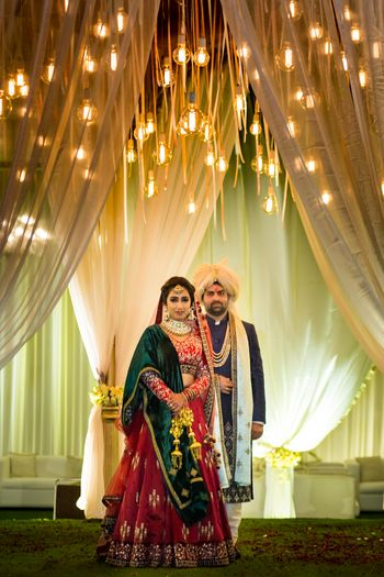 Couple portrait with bulbs hanging overhead