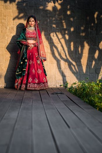 Wedding day bridal shot in red and green lehenga
