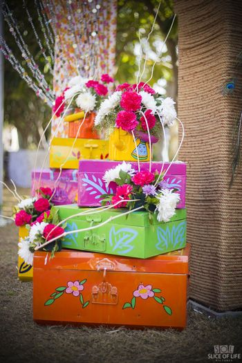 Colourful decor idea with trunks and florals