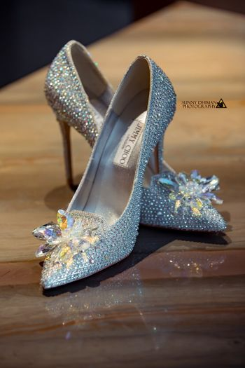 Light blue and silver studded jimmy choo shoes for bride
