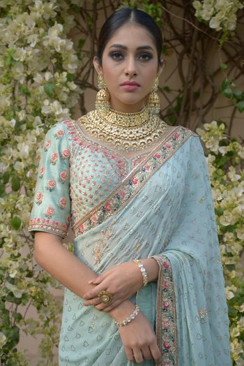 Stunning pastel saree in powder blue and bridal jewellery