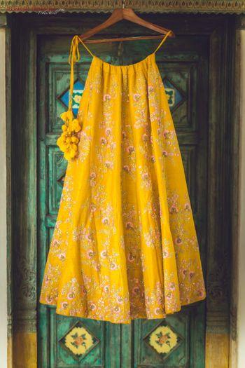 Yellow lehenga with tassels