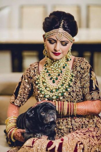 Photo of Bride getting ready shot with pet dog